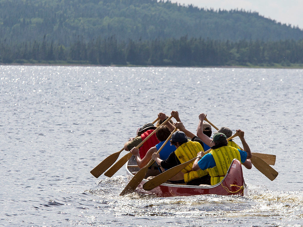 Group of Rover Scouts paddling a canoe